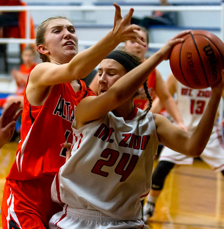 Altamont's JoAnna Schultz, left, defends against Mt. Zion's Lainie Wolter. Schultz had 10 points and nine rebounds in the 51-49 loss.