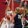 St. Anthony's Olivia Clausius, left, and Abbie Schmidt, right, double team Teutopolis' Jamie Sandschafer. Sandschafer kept the Shoes in the game during the first half with 12 of the team's 17 points