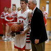 Effingham's Grant Wolfe is presented with the game ball from when he scored his 1,000th career point last February prior to Effingham's game against Mattoon, with coach Ron Reed joining him during the brief ceremony.