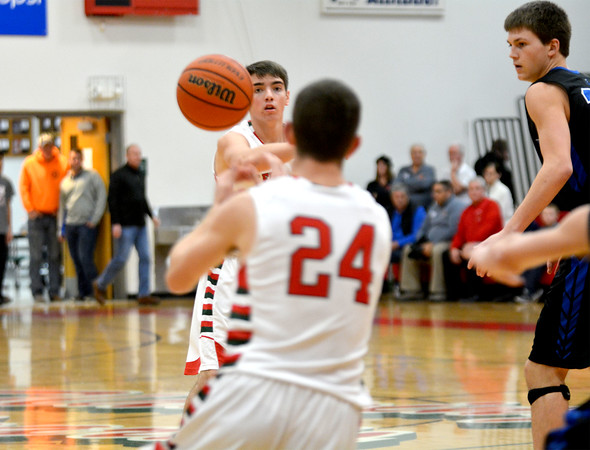 Effingham's Brent Beals (background) throws a pass to Grant Wolfe (foreground) in a game against Lincoln-Way East.