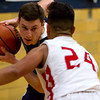 South Central's Trevor Markley, left, decides his next move against Vandalia's Kelly Jones. The Cougars fell 84-55.