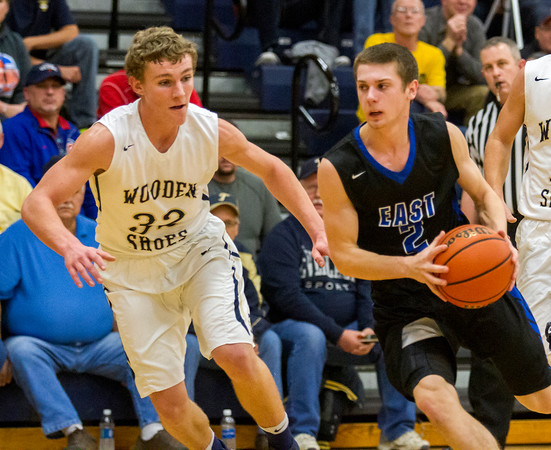 Teutopolis' Chris Ungrund, left, defends against Lincoln-Way East's Zach Parduhn. Ungrund had three steals in the third, a period in which the Shoes' defense turned up the heat to hold the Griffins to 13 points in the entire second half.
