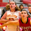 Effingham's Sidney Webster, right, boxes out against Charleston's Bernie Jackson, left. The Lady Hearts outrebounded the Trojans 31-20.