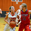 Altamont's Tinley Mette drives to the basket while St. Anthony's Meg Richards guards her during a St. Anthony win.