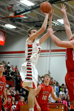 Effingham's Jacob Donaldson shoots a short jump shot in the final seconds of the first half in a 79-64 win over Mt. Zion.