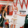 Effingham's Natalie Carie takes a jump shot between Mattoon defenders Ashlyn McDonald (left) and Isabella Coffey (right) at Effingham High School.