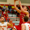 Effingham's Landon Wolfe drives between Charleston's Blaze Taylor-Lutz, left, and Ridge Boyer, right, during the Flaming Hearts' win in Charleston.