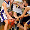 12-7-12<br /> Northwestern HS vs Taylor HS Girls Basketball<br /> Taylor's Cami Hansen losses the ball to Northwester's Erin Kesler with others moving in the 3rd quarter.<br /> KT photo | Tim Bath