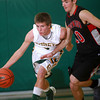 12-8-12<br /> Eastern Bball<br /> Eastern's KJ Myers dribbles the ball down the court as Southwood's Robbie Cole guards him during Saturday night's game.<br /> KT photo | Kelly Lafferty
