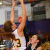 12-7-12<br /> Northwestern HS vs Taylor HS Girls Basketball<br /> Northwestern's Erin Kesler shooting with Taylor's Brie Boehler trying to block.<br /> KT photo | Tim Bath