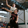 12-8-12<br /> Eastern Bball<br /> Eastern's Grant Cole goes up for a point as Southwood's Nathan Hollars tries to block him during Saturday night's game.<br /> KT photo | Kelly Lafferty
