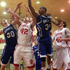 12-4-12<br /> IUK basketball<br /> IUK's Jacob Faust goes up for the rebound against Brescia's Hunter Rowe and Brett Jackson during Tuesday night's game.<br /> KT photo | Kelly Lafferty