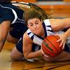 12-7-12<br /> Northwestern HS vs Taylor HS Girls Basketball<br /> Northwestern's Erin Kesler scrambling to get a loose ball. The Taylor player is Lauran Reece.<br /> KT photo | Tim Bath