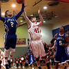 12-4-12<br /> IUK basketball<br /> IUK's Joby Renbarger tries to get the rebound before Brescia's Jermain Langley does during Tuesday night's game.<br /> KT photo | Kelly Lafferty