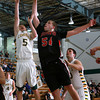 12-8-12<br /> Eastern Bball<br /> Eastern's Braden Gibson and Southwood's Shane Smith jump up for the rebound during Saturday night's game.<br /> KT photo | Kelly Lafferty