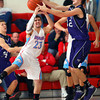 12-14-12<br /> Northwestern HS vs Maconaqua HS Boys Basketball<br /> Maconaqua's Nick Love and NW's Chase Johnson fighting for a rebound on a Northwestern shot in the first quarter.<br /> KT photo | Tim Bath