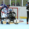 Americans Alberto Flore backhands a shot on net Matty Gilchrest makes the save