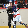 Americans Mike Defazio and Saints Andrew Goduco tangle up with each other