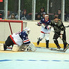 Americans goalie deflects the ball away from getting to Evan Sousa