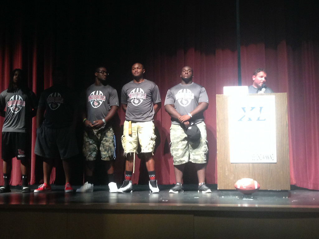 The Druid Hills High School players listened as their Head Coach Adams previewed their upcoming season