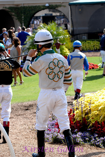 The jockeys are they approach the circle to meet and greet with the owners.
