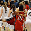 Halle Jones of Denver East jumps in the arms of Missy Patterson (30) after the Angels beat Legacy to win the 5A State Championship.<br /> <br /> Cliff Grassmick / March 12, 2010