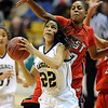 Kailey Edwards of Legacy ducks under Shae Kelley of Denver East.<br /> Cliff Grassmick / March 12, 2010
