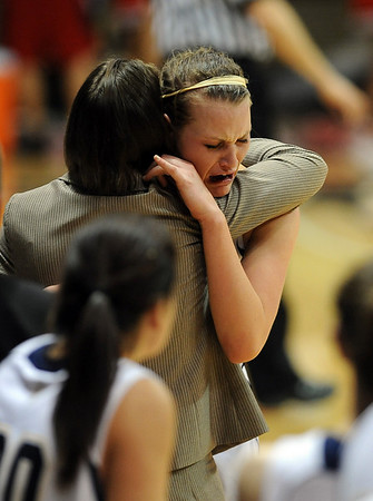 Carli Moreland  of Legacy is comforted by coach Jamie Carey after she fouled out of the game with Denver East.<br /> <br /> Cliff Grassmick / March 12, 2010