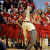 Denver East coach, Dwight Berry, slips on the ice, but keeps his balance, after being doused with water after East won the 5A State Championship over Legacy.<br /> <br /> Cliff Grassmick / March 12, 2010