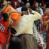 Denver East coach, Dwight Berry, gets doused with water after East won the 5A State Championship over Legacy on Friday.<br /> <br /> Cliff Grassmick / March 12, 2010