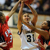 Sade Akindele of Legacy drives to the basket against Legacy in the 5A state game.<br /> Cliff Grassmick / March 12, 2010