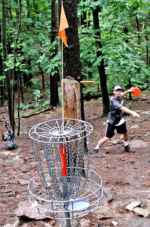 . Paul Adorno,36 of Connecticut, winds up to throw during a Disc Golf tournament in Devens. SUN/David H. Brow