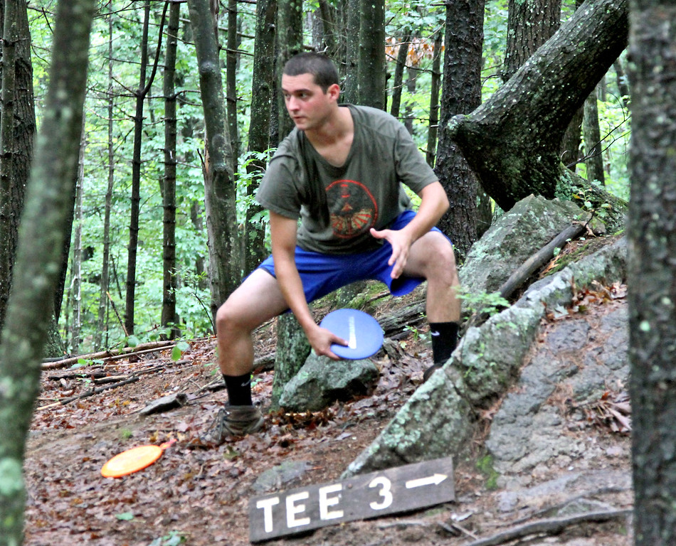 . Tyler Blanchet,24, of Connecticut, shoots to the next tee in a Disc Golf tournament in Devens. SUN/David H. Brow