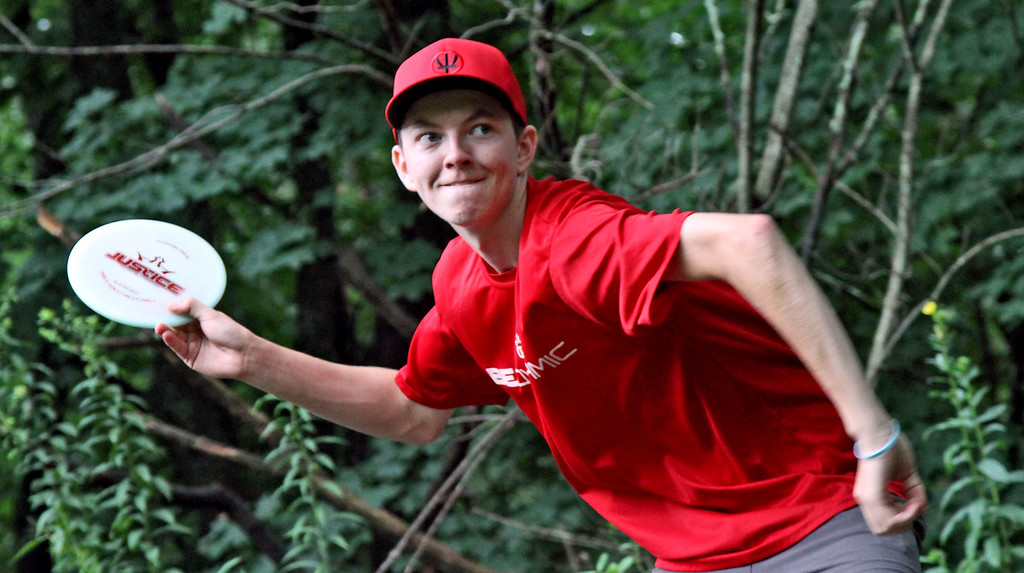 . Local player, Casey White,18, of Shirley, shows his style in playing Disc Golf in Devens. SUN/David H. Brow
