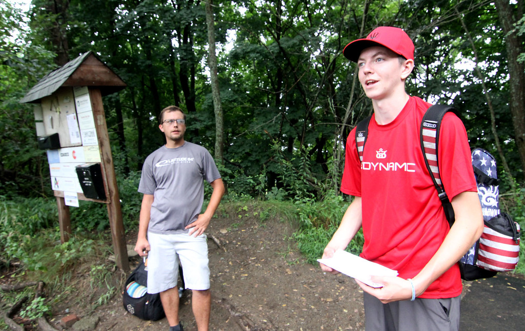 . Disc Golf players L-R, Shane Wyatt,27 of Norwood and local Casey White,18 of Shirley, talk about their latest round at Disc Golf in Devens. SUN/David H. Brow