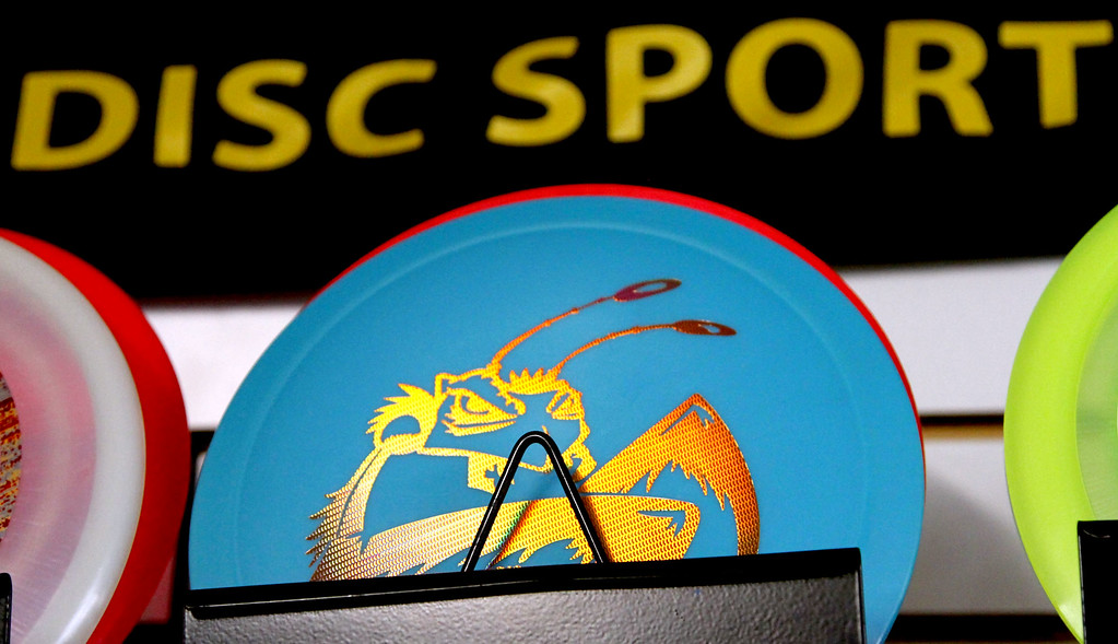 . On display in the Hawk\'s Nest store in Ayer is a close-up of a disc used in playing Disc Golf. SUN/David H. Brow