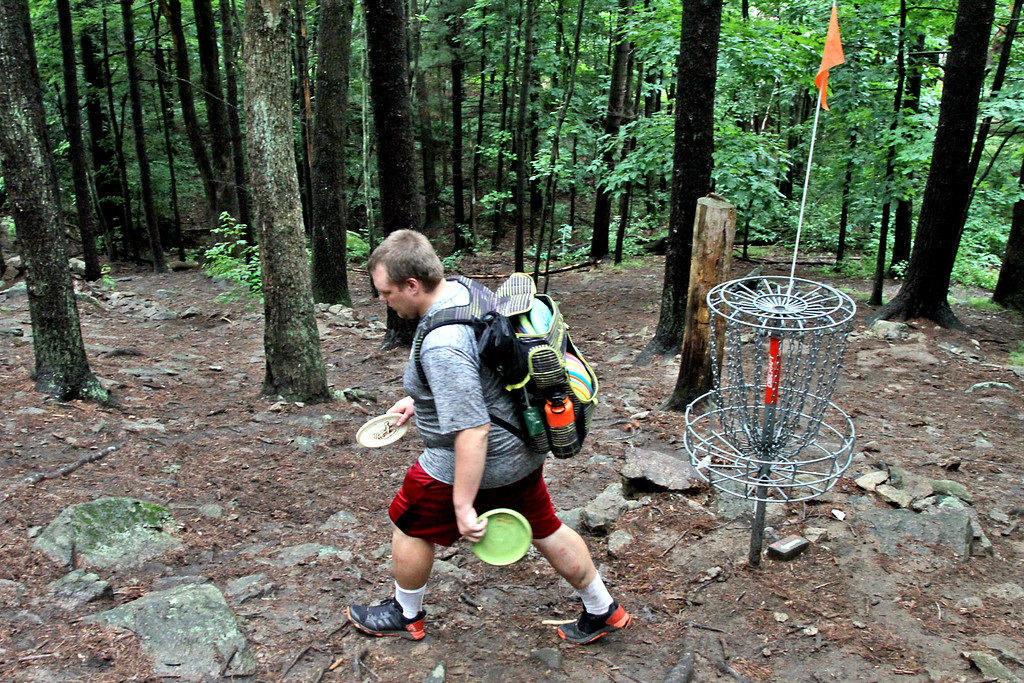 . Chris Spear,26, of Connecticut, leaves the Disc Golf course after finishing the last hole (or basket). SUN/David H. Brow