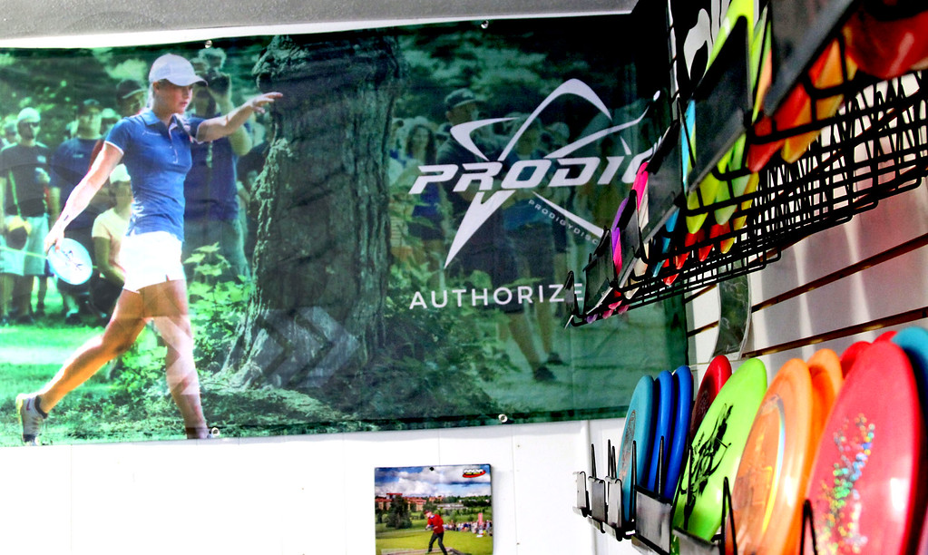 . Shown here in the Hawks Nest store in Ayer is a poster of someone playing Disc Golf. SUN/David H. Brow