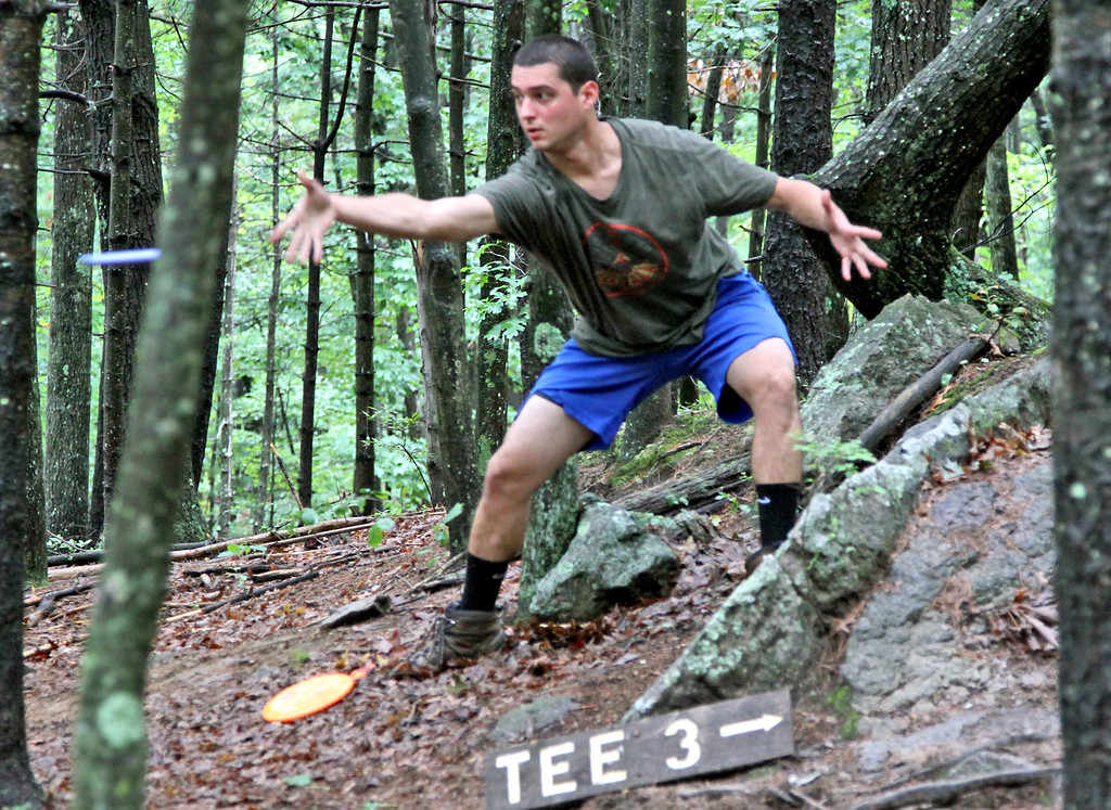 . Tyler Blanchet lets the disc fly during a Disc Golf tournament in Devens. SUN/David H. Brow