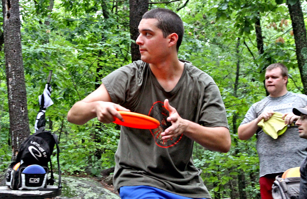 . Tyler Blanchet,24, of Connecticut shoots his disc in the Disc Golf tournament in Devens. SUN/David H. Brow
