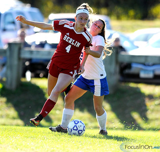 10/11/2016  Mike Orazzi | Staff Berlin's Tess Atkinson (4) and Bristol Eastern's Jenny Soucy (3) during Tuesday's soccer match in Bristol.