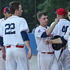 Dirt Dawgs #2 Vincent Sharkey celebrates with teammates after scoring a run during the game against the Brockton Rox on Tuesday evening at Doyle Field in Leominster. SENTINEL & ENTERPRISE / Ashley Green