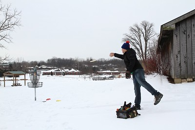 Jeremy Sumpter putts from behind the barn in the 2015 Ice Bowl held at the Avon Town Hall Disc Golf Course.