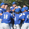 Lunenburg's Craig Powell is engulfed by a sea of blue jerseys after his home run gave the Blue Knights a walk off win in the eighth inning. Nashoba Valley Voice/Ed Niser