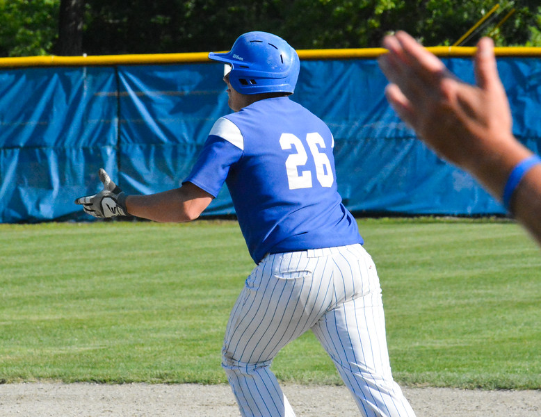 Lunenburg's Craig Powell claps his hands as he watches the ball sail over the left-center field fence in the eighth inning of Thursday's game. Nashoba Valley Voice/Ed Niser