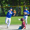 Lunenburg shortstop Dason Stacy records a force out at second while turning a doubleplay as Jarrod Oberg slides in. Nashoba Valley Voice/Ed Niser