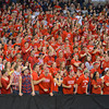 RYAN HUTTON/ Staff photo.<br /> Central Catholic fans celebrate a basket during the first half of Saturday night's game at the Tsongas Center in Lowell.