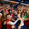 RYAN HUTTON/ Staff photo.<br /> Central Catholic's Patrick Sullivan leaps into the stands as Central Catholic fans celebrate their teams 59-53 victory over Andover.