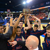 RYAN HUTTON/ Staff photo.<br /> The Central Catholic boys basketball team hoists its trophy after downing Andover 59-53.