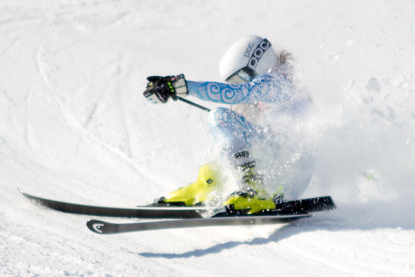 Record-Eagle/Brett A. Sommers Petoskey's Emma Makela falls on giant slalom course during Monday's MHSAA Division 2 ski finals.